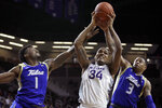 Kansas State forward Levi Stockard III (34) rebounds between Tulsa forward Martins Igbanu (1) and guard Elijah Joiner (3) during the second half of an NCAA college basketball game in Manhattan, Kan., Sunday, Dec. 29, 2019. (AP Photo/Orlin Wagner)