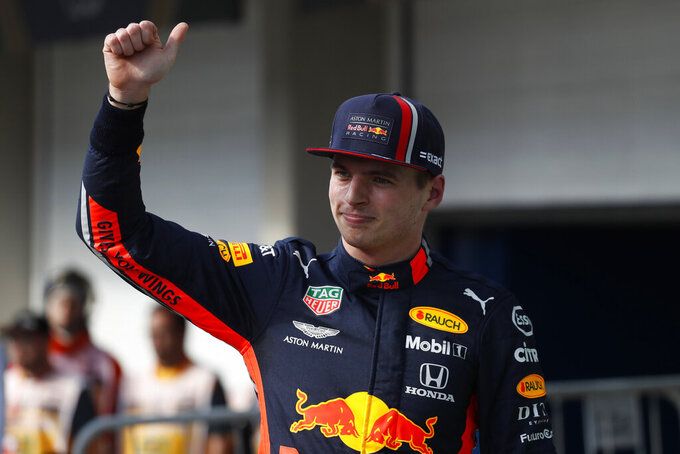 Red Bull driver Max Verstappen, of the Netherlands, gives a thumbs up after taking pole position during the qualifying session for the Formula One Brazil Grand Prix at the Interlagos race track in Sao Paulo, Brazil, Saturday, Nov. 16, 2019. (AP Photo/Nelson Antoine)