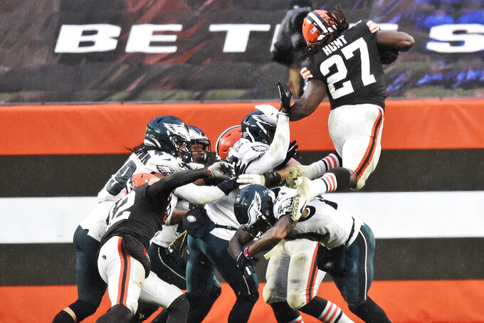 Cleveland Browns running back Kareem Hunt (27) rushes for a five-yard touchdown during the second half of an NFL football game against the Philadelphia Eagles, Sunday, Nov. 22, 2020, in Cleveland. (AP Photo/David Richard)