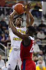 Northern Kentucky guard Jalen Tate (11) shoots over Illinois-Chicago guard Godwin Boahen (25) during the first half of an NCAA college basketball game for the Horizon League men's tournament championship in Indianapolis, Tuesday, March 10, 2020. (AP Photo/Michael Conroy)