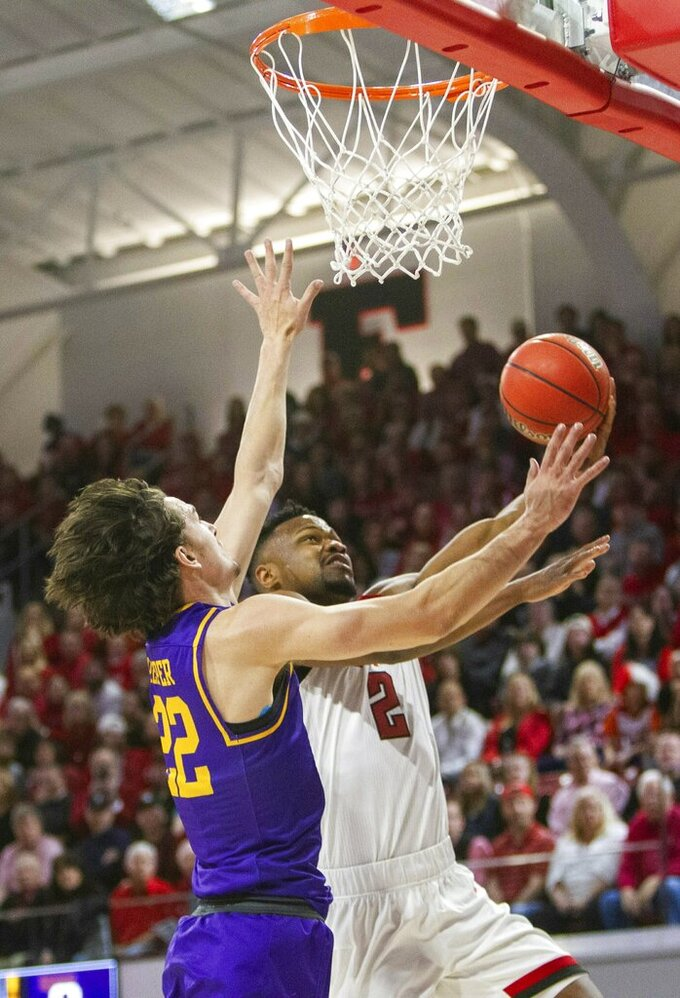 North Carolina State's Torin Dorn (2) drives to the basket past Lipscomb's Eli Pepper (22) during the first half of an NCAA college basketball game in the quarterfinals of the NIT on Wednesday, March 27, 2019, in Raleigh, N.C. (Travis Long/The News & Observer via AP)