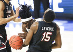 Florida forward Anthony Duruji is fouled by South Carolina forward Wildens Leveque (15) during the first half of an NCAA college basketball game Wednesday, Feb. 3, 2021, in Gainesville, Fla. (AP Photo/Matt Stamey)