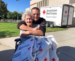 Jonathan Stahl, 41, of Valencia, Calif., and his 91-year-old grandmother Beverly Stahl of the Sylmar area of Los Angeles, pose at the evacuation center at the Sylmar Recreation Center after the Saddleridge wildfire Friday, Oct. 11, 2019. (AP Photo/Stefanie Dazio)