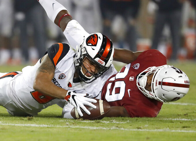 Oregon State wide receiver Trevon Bradford (8) can't make the catch against Stanford cornerback Kendall Williamson (29) in the second half during an NCAA college football game on Saturday, Nov. 10, 2018, in Stanford, Calif. Stanford won 48-17. (AP Photo/Tony Avelar)