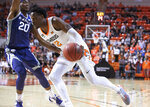 Oklahoma State forward Cameron McGriff (12) drives into the defense of Kansas State forward Xavier Sneed (20) during the first half of an NCAA college basketball game in Stillwater, Okla., Wednesday, March 4, 2020. (AP Photo/Brody Schmidt)