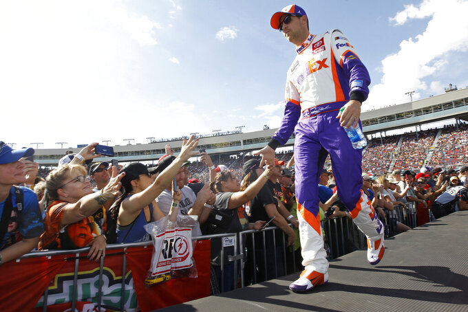 Denny Hamlin greets fans during driver introductions prior to the NASCAR Cup Series auto race at ISM Raceway, Sunday, Nov. 10, 2019, in Avondale, Ariz. (AP Photo/Ralph Freso)