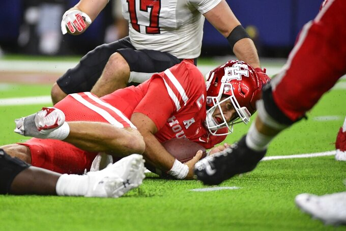 Houston quarterback Clayton Tune (3) is sacked by Texas Tech during the second half of an NCAA college football game Saturday, Sept. 4, 2021, in Houston. (AP Photo/Justin Rex)