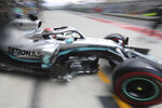 Mercedes driver Lewis Hamilton of Britain steers out of the garage during the first practice session of the Chinese Formula One Grand Prix at the Shanghai International Circuit in Shanghai on Friday, April 12, 2019. (AP Photo/Ng Han Guan)
