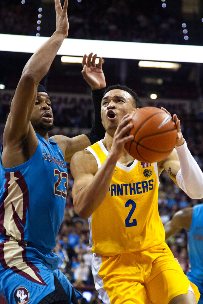 Pittsburgh guard Trey McGowens (2) drives the lane against Florida State guard M.J. Walker (23) during the first half of an NCAA college basketball game in Tallahassee, Fla., Tuesday, Feb. 18, 2020. (AP Photo/Mark Wallheiser)
