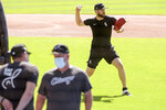 Chicago White Sox pitcher Lucas Giolito sets up to throw the ball to first base during practice at Guaranteed Rate Field on Sunday, July 5, 2020, in Chicago. (AP Photo/Mark Black)