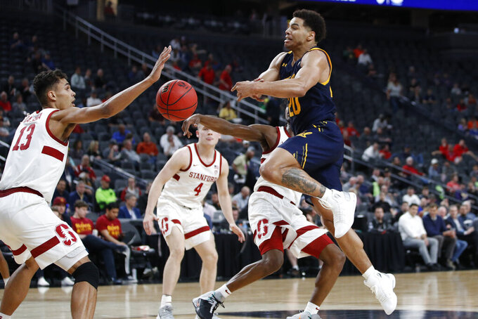 California's Matt Bradley (20) is stripped of the ball by Stanford during the first half of an NCAA college basketball game in the first round of the Pac-12 men's tournament Wednesday, March 11, 2020, in Las Vegas. (AP Photo/John Locher)