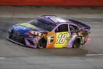 Kyle Busch (18) drives during the NASCAR Cup Series auto race Wednesday, May 20, 2020, in Darlington, S.C. (AP Photo/Brynn Anderson)