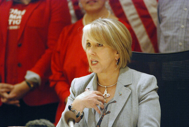 New Mexico Gov. Michelle Lujan Grisham signed a red-flag gun bill Tuesday, Feb. 25, 2020, in Santa Fe, N.M., that allows state district courts to order the temporary surrender of firearms. The Democratic governor urged sheriffs to resign if they refuse to enforce the new law that can temporarily remove guns from people that may pose an immediate safety threat to themselves of others. (AP Photo/Morgan Lee)