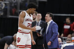 Indiana head coach Archie Miller talks with Jerome Hunter (21) during the second half of an NCAA college basketball game against Nebraska at the Big Ten Conference tournament, Wednesday, March 11, 2020, in Indianapolis. Indiana won 89-64. (AP Photo/Darron Cummings)