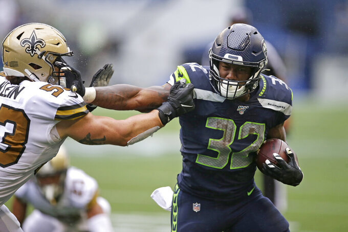 Seattle Seahawks' Chris Carson (32) pushes off New Orleans Saints' A.J. Klein as he tries to get past him during the second half of an NFL football game, Sunday, Sept. 22, 2019, in Seattle. (AP Photo/Scott Eklund)