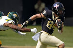 Wake Forest wide receiver Jackson Hensley runs past Norfolk State defensive back Stuart Anderson Jr. during the second half of a NCAA college football game Saturday, Sept. 11, 2021, in Winston-Salem, N.C. (AP Photo/Chris Carlson)
