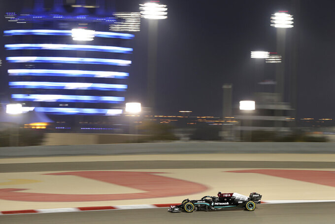 Mercedes driver Lewis Hamilton of Britain steers his car during the second free practice at the Formula One Bahrain International Circuit in Sakhir, Bahrain, Friday, March 26, 2021. The Bahrain Formula One Grand Prix will take place on Sunday. (AP Photo/Kamran Jebreili)