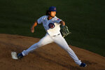 Chicago Cubs starting pitcher Yu Darvish delivers during the third inning of a baseball game against the Milwaukee Brewers, Thursday, Aug. 13, 2020, in Chicago. (AP Photo/Jeff Haynes)