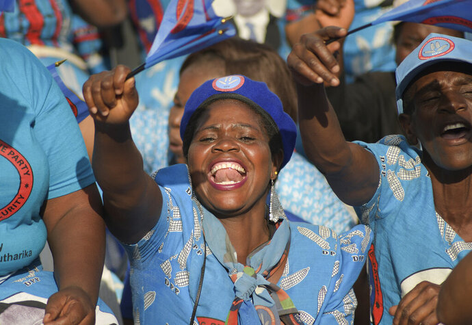 Democratic Progressive Party (DPP) supporters attend a final election rally led by Malawian President, Peter Mutharika, in Blantyre, Malawi Saturday, May 18, 2019. Corruption and the need for economic growth are the main campaign issues as Malawi goes to the polls on Tuesday for a presidential election that pits the incumbent 78-year-old president Peter Mutharika of the ruling Democratic Progressive Party against his own vice president, 46-year-old Saulos Chilima as well as the main opposition party leader Lazarus Chakwera, 64. (AP Photo/Thoko Chikondi)