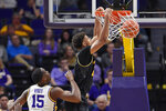 Missouri forward Tray Jackson (2) dunks the ball in front of LSU guard Aundre Hyatt (15) in the first half of an NCAA college basketball game, Tuesday, Feb. 11, 2020, in Baton Rouge, La. (AP Photo/Bill Feig)