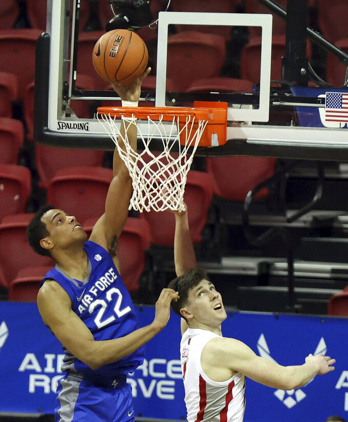 Air Force forward Nikc Jackson (22) shoots as UNLV guard Caleb Grill (3) defends during the second half of an NCAA college basketball game in the first round of the Mountain West Conference men's tournament Wednesday, March 10, 2021, in Las Vegas. (AP Photo/Isaac Brekken)