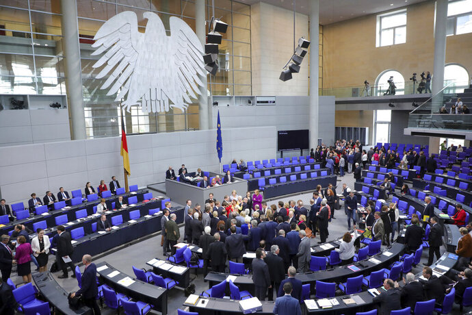Lawmakers attend a polling at the German federal parliament, Bundestag, at the Reichstag building in Berlin, Germany, Friday, May 17, 2019. German lawmakers have approved a resolution denouncing the Boycott, Divest and Sanctions movement against Israel and describing its methods as anti-Semitic. (Wolfgang Kumm/dpa via AP)