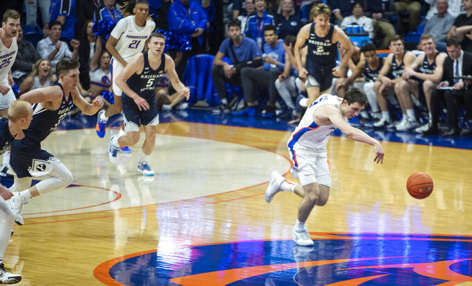Boise State guard Justinian Jessup leads a break after a steal against BYU during an NCAA college basketball game Wednesday, Nov. 20, 2019, in Boise, Idaho. Boise State won 72-68. (Darin Oswald/Idaho Statesman via AP)