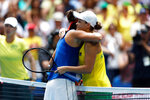 Australia's Ashleigh Barty hugs France's Caroline Garcia at the net after their Fed Cup tennis final in Perth, Australia, Saturday, Nov. 9, 2019. (AP Photo/Trevor Collens)