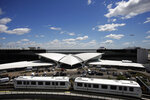 The TWA terminal at New York's John F. Kennedy International Airport comes out of retirement to open as a hotel, Wednesday, May 15, 2019. The Finnish architect Eero Saarinen didn't have a hotel in mind when he designed the futuristic structure that opened in 1962. The AirTrain, which links terminals to the subway system, passes in front of the hotel. (AP Photo/Mark Lennihan)