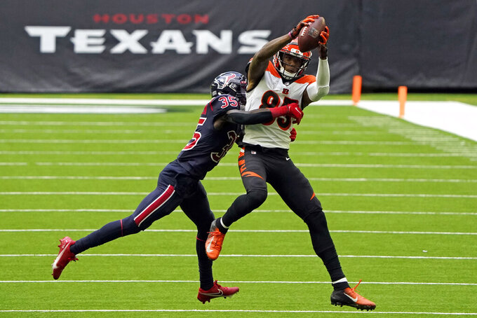 Cincinnati Bengals wide receiver Tee Higgins (85) catches a pass for a first down as Houston Texans cornerback Keion Crossen (35) defends during the second half of an NFL football game Sunday, Dec. 27, 2020, in Houston. (AP Photo/Sam Craft)