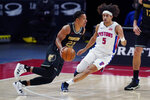 Memphis Grizzlies guard Desmond Bane (22) drives as Detroit Pistons guard Frank Jackson (5) defends during the first half of an NBA basketball game, Thursday, May 6, 2021, in Detroit. (AP Photo/Carlos Osorio)