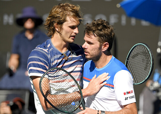 Germany's Alexander Zverev, left, is congratulated by Switzerland's Stan Wawrinka after winning their quarterfinal match at the Australian Open tennis championship in Melbourne, Australia, Wednesday, Jan. 29, 2020. (AP Photo/Andy Brownbill)