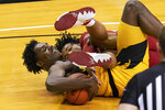 Missouri's Kobe Brown, left, and Arkansas' Jaylin Williams grapple for a loose ball during the first half of an NCAA college basketball game Saturday, Feb. 13, 2021, in Columbia, Mo. (AP Photo/L.G. Patterson)