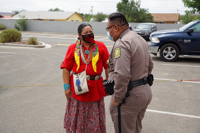 Navajo Nation Council Delegate Amber Kanazbah Crotty, left, speaks with Captain Leonard Redhorse III of the Navajo Nation Shiprock Police Department at an award ceremony for Utah Navajo Health System's victim advocacy program in Montezuma Creek, Utah on Wednesday, July 14, 2021. Crotty wants to see similar programs created across the Navajo Nation. (Zak Podmore /The Salt Lake Tribune via AP)