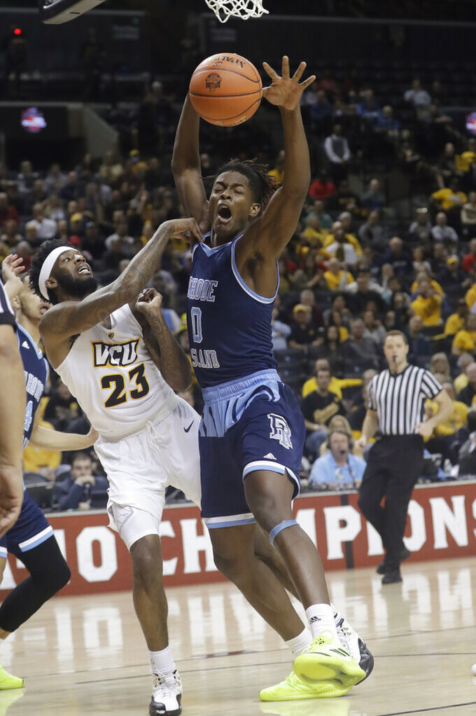 VCU's Issac Vann (23) passes away from Rhode Island's Jermaine Harris (0) during the first half of an NCAA college basketball game in the Atlantic 10 men's tournament Friday, March 15, 2019, in New York. (AP Photo/Frank Franklin II)