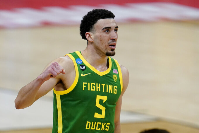 Oregon guard Chris Duarte (5) celebrates after beating Iowa 95-80 in a men's college basketball game in the second round of the NCAA tournament at Bankers Life Fieldhouse in Indianapolis, Monday, March 22, 2021. (AP Photo/Paul Sancya)
