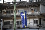 National flags in Nauru for the Pacific Islands Forum on the tiny Pacific nation of Nauru, Monday, Sept. 3, 2018. The Pacific Islands Forum conference starts in Nauru on Monday night. The forum brings together 18 members including Australia and New Zealand to discuss regional issues. (Jason Oxenham/Pool Photo via AP)