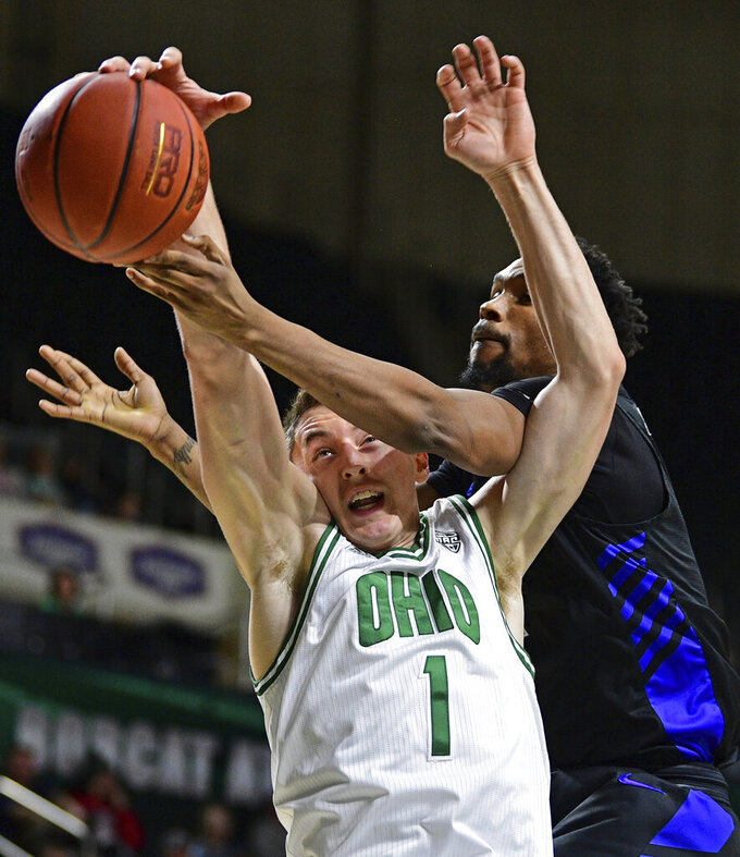 Ohio forward Jason Carter, left, reaches for a rebound next to Buffalo forward Montel McRae during the first half of an NCAA college basketball game Tuesday, March 5, 2019, in Athens, Ohio. (AP Photo/David Dermer)