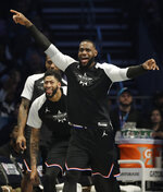 CORRECTS TO THE LAKERS, NOT THE CAVALIERS - Team LeBron's LeBron James, of the Los Angeles Lakers, celebrates a basket against Team Giannis during the second half of an NBA All-Star basketball game, Sunday, Feb. 17, 2019, in Charlotte, N.C. (AP Photo/Chuck Burton)