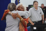 Judge Betsy Benson is hugged by Broward Supervisor of Elections Brenda Snipes, Sunday, Nov. 18, 2018, at the Broward Supervisor of Elections office in Lauderhill, Fla. Broward County reported their recount results with 52 minutes to spare Sunday. (Joe Cavaretta/South Florida Sun-Sentinel via AP)