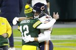 Green Bay Packers' Aaron Rodgers hugs Chicago Bears' Jimmy Graham after an NFL football game against the Chicago Bears Sunday, Nov. 29, 2020, in Green Bay, Wis. The Packers won 41-25. (AP Photo/Mike Roemer)