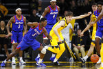 DePaul guard Jalen Coleman-Lands (5) fights for a loose ball with Iowa forward Patrick McCaffery during the first half of an NCAA college basketball game, Monday, Nov. 11, 2019, in Iowa City, Iowa. (AP Photo/Charlie Neibergall)