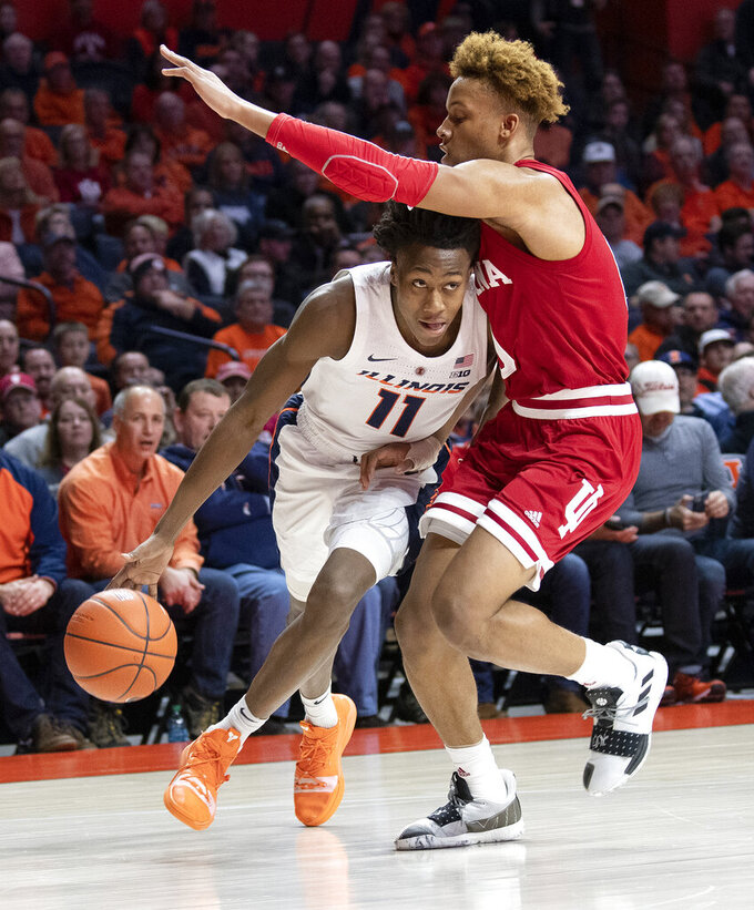 Illinois guard Trent Frazier (1) drives to the basket past Indiana guard Romeo Langford during the first half of an NCAA college basketball game in Champaign, Ill., Thursday, March 7, 2019. (AP Photo/Stephen Haas)