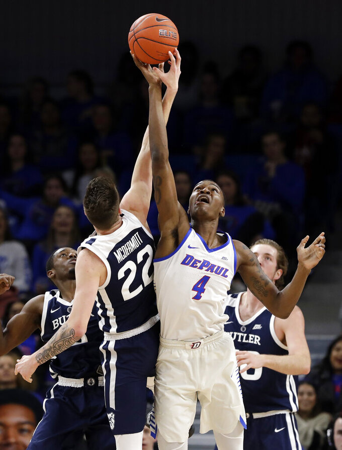 DePaul forward Paul Reed, right, and Butler forward Sean McDermott (22) battle for a rebound during the first half of an NCAA college basketball game Wednesday, Jan. 16, 2019, in Chicago. (AP Photo/Nam Y. Huh)