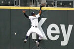 Seattle Mariners right fielder Mallex Smith hits the wall as he misses a deep fly ball from Colorado Rockies' Charlie Blackmon for a three-run double during the fifth inning of a baseball game Saturday, Aug. 8, 2020, in Seattle. (AP Photo/Elaine Thompson)