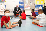 New Jersey Gov. Phil Murphy talks to 3- and 4-year old students in a pre-K class at the Dr. Charles Smith Early Childhood Center, Thursday, Sept. 16, 2021, in Palisades Park, N.J. Murphy toured the school before announcing plans to plans to provide universal pre-K for all families in New Jersey. (AP Photo/Mary Altaffer)
