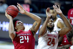 Rutgers guard Ron Harper Jr., left, goes up for a shot against Maryland forward Donta Scott during the second half of an NCAA college basketball game, Monday, Dec. 14, 2020, in College Park, Md. Rutgers won 74-60. (AP Photo/Julio Cortez)