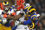 Cincinnati Bengals running back Joe Mixon, center, runs against Los Angeles Rams outside linebacker Samson Ebukam (50) during the second half of an NFL football game, Sunday, Oct. 27, 2019, at Wembley Stadium in London. (AP Photo/Frank Augstein)