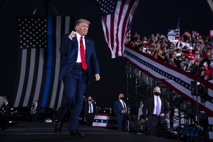 President Donald Trump arrives to speak to a campaign rally at Middle Georgia Regional Airport, Friday, Oct. 16, 2020, in Macon, Ga. (AP Photo/Evan Vucci)