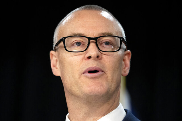 New Zealand Health Minister David Clark announces his resignation at a press conference at parliament in Wellington, New Zealand Thursday, July 2, 2020. Clark resigned Thursday following a series of personal blunders during the coronavirus pandemic. (Mark Mitchell/New Zealand Herald via AP)